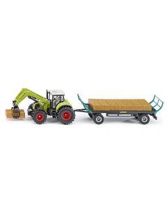 Claas Traktor mit Quaderballengreifer und Ballenwagen
